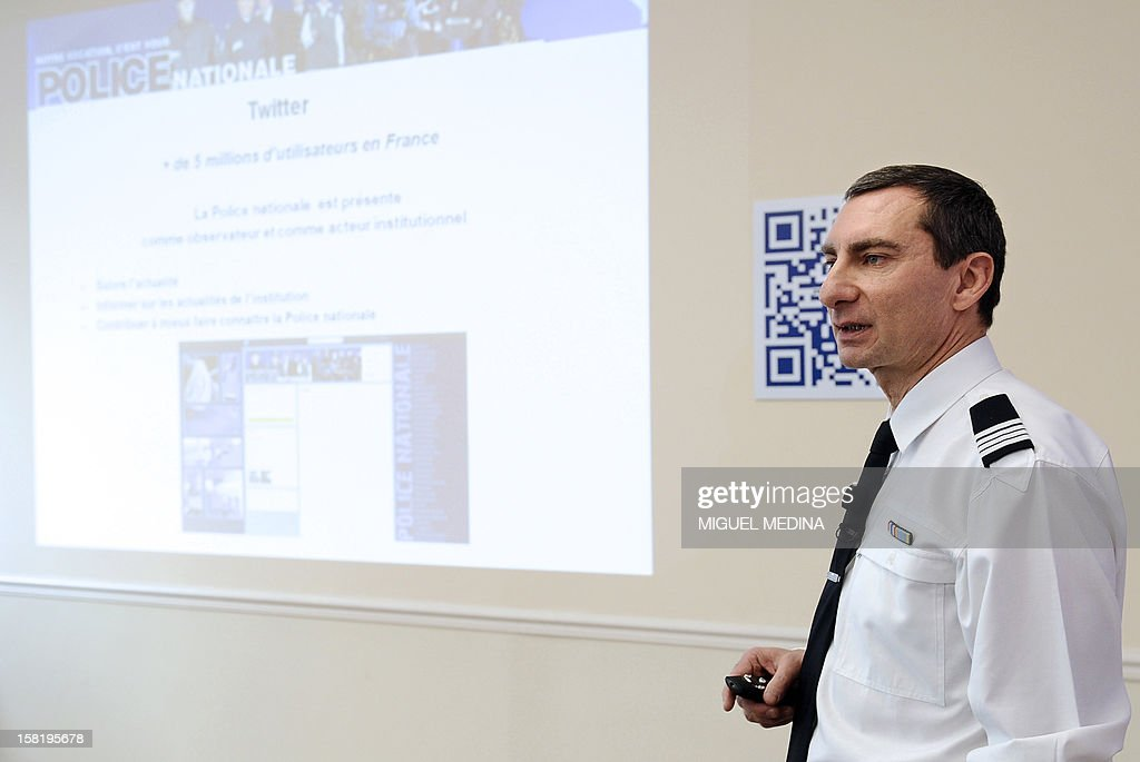Pascal Garibian, spokesman of the French National Police presents the development of the Police visibility on the Internet and its entry on social networks on December 11, 2012 in Paris. AFP PHOTO MIGUEL MEDINA