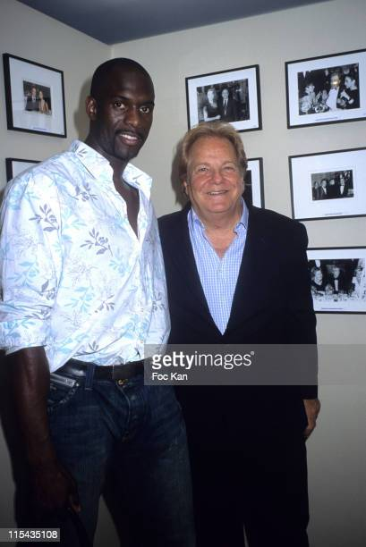 Pascal Gentil and Massimo Gargia during Massimo Gargia's Photographs Collection Exhibition April 27 2006 at Royal Monceau Hotel in Paris France