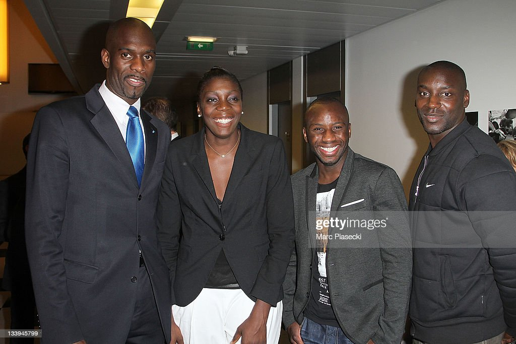 Pascal Gentil, Gladys Espangue and Ladji Doucoure (R) attend the Sport'A Vie Gala event at Stade de France on November 22, 2011 in Paris, France.