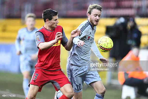 Pascal Gregor of FC Nordsjalland and Rasmus Jonsson of AaB Aalborg compete for the ball during the Danish Alka Superliga match between FC...