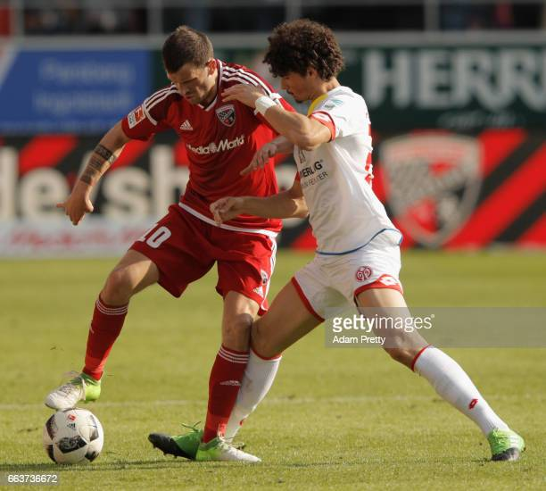 Pascal Grofl of Ingolstadt is challenged by André Ramalho of Mainz during the Bundesliga match between FC Ingolstadt 04 and 1 FSV Mainz 05 at Audi...