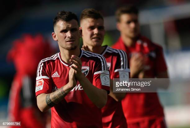 Pascal Gross and Max Christiansen of Ingolstadt and team mates react dejected after the Bundesliga match between FC Ingolstadt 04 and Bayer 04...