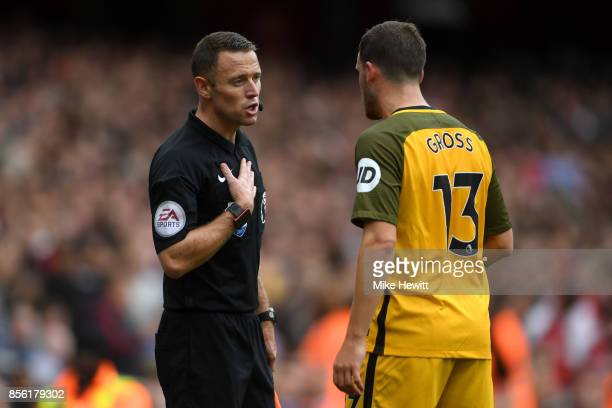 Pascal Gross of Brighton and Hove Albion argues with linesmen Stuart Burt during the Premier League match between Arsenal and Brighton and Hove...