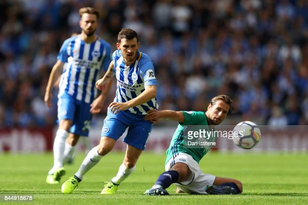 Pascal Gross of Brighton and Hove Albion battles for the ball with Grzegorz Krychowiak of West Bromwich Albion during the Premier League match...