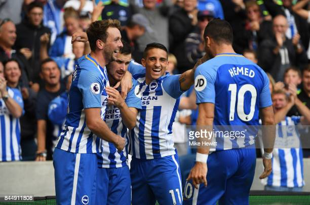 Pascal Gross of Brighton and Hove Albion celebrates scoring his sides second goal with his Brighton and Hove Albion team mates during the Premier...