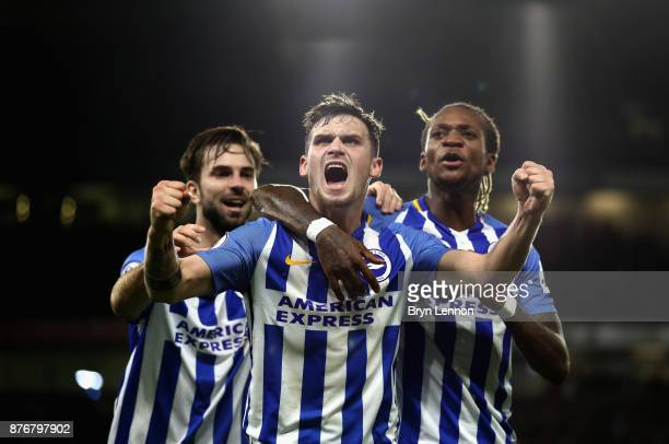 Pascal Gross of Brighton and Hove Albion celebrates scoring his side's first goal with Davy Propper and Gaetan Bong during the Premier League match...