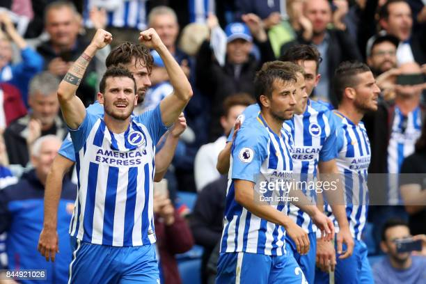 Pascal Gross of Brighton and Hove Albion celebrates with teammates after scoring the opening goal during the Premier League match between Brighton...