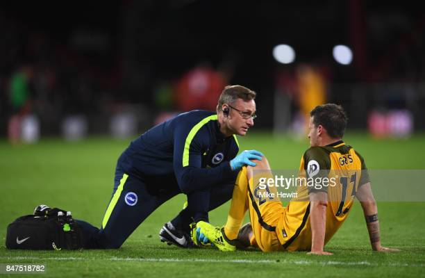 Pascal Gross of Brighton and Hove Albion is given treatment during the Premier League match between AFC Bournemouth and Brighton and Hove Albion at...