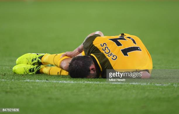 Pascal Gross of Brighton and Hove Albion is injured during the Premier League match between AFC Bournemouth and Brighton and Hove Albion at Vitality...