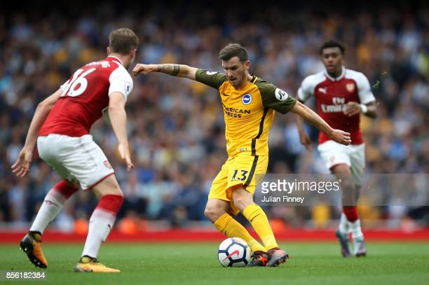 Pascal Gross of Brighton and Hove Albion shoots during the Premier League match between Arsenal and Brighton and Hove Albion at Emirates Stadium on...