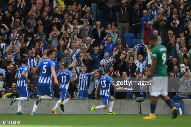 Pascal Gross of Brighton celebrates his team's first ever Premier League goal during the Premier League match between Brighton and Hove Albion and...