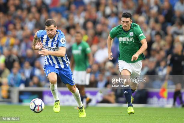 Pascal Gross of Brighton gets away from Gareth Batty of WBA to score his second goal during the Premier League match between Brighton and Hove Albion...