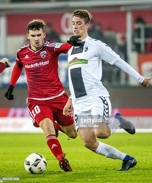 Pascal Gross of FC Ingolstadt 04 is challenged by Janik Haberer of SC Freiburg during the Bundesliga match between FC Ingolstadt 04 and SC Freiburg...