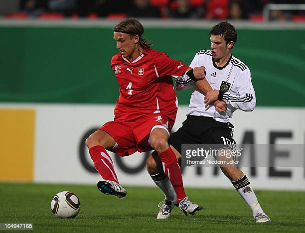 Pascal Gross of Germany fights for the ball with Michael Lang of Switzerland with Janko Pacar of Switzerland during the men's U20 International...