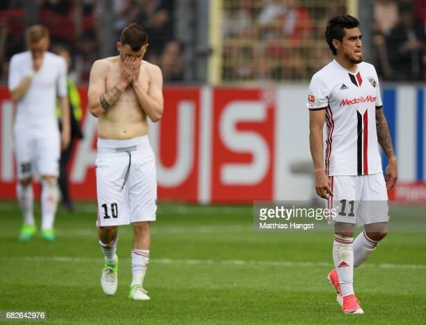 Pascal Gross of Ingolstadt and Dario Lezcano of Ingolstadt show their disappointment after the Bundesliga match between SC Freiburg and FC Ingolstadt...