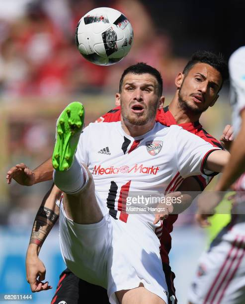Pascal Gross of Ingolstadt and Onur Bulut of Freiburg compete for the ball during the Bundesliga match between SC Freiburg and FC Ingolstadt 04 at...