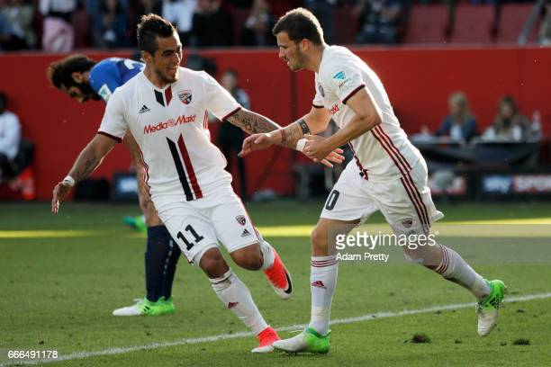Pascal Gross of Ingolstadt celebrates his team's first goal with team mate Dario Lezcano during the Bundesliga match between FC Ingolstadt 04 and SV...