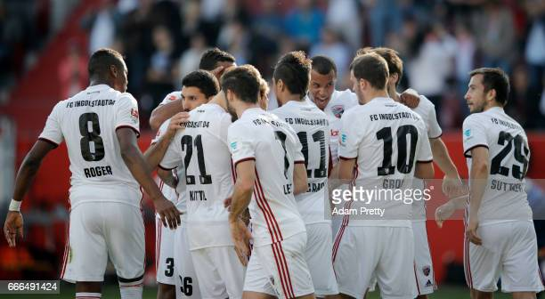 Pascal Gross of Ingolstadt celebrates his team's first goal with team mateas during the Bundesliga match between FC Ingolstadt 04 and SV Darmstadt 98...