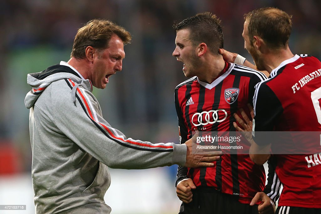 Pascal Gross of Ingolstadt celebrates scoring the opening goal with his head coach Ralph Hasenhuettl during the Second Bundesliga match between FC...