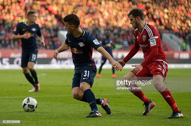 Pascal Gross of Ingolstadt fights for the ball with Diego Demme of Leipzig during the Bundesliga match between FC Ingolstadt 04 and RB Leipzig at...