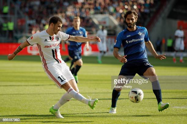Pascal Gross of Ingolstadt is challenged by Hamit Altintop of Darmstadt during the Bundesliga match between FC Ingolstadt 04 and SV Darmstadt 98 at...