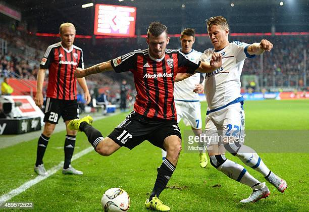 Pascal Gross of Ingolstadt is challenged by Matthias Ostrzolek of Hamburg during the Bundesliga match between FC Ingolstadt and Hamburger SV at Audi...