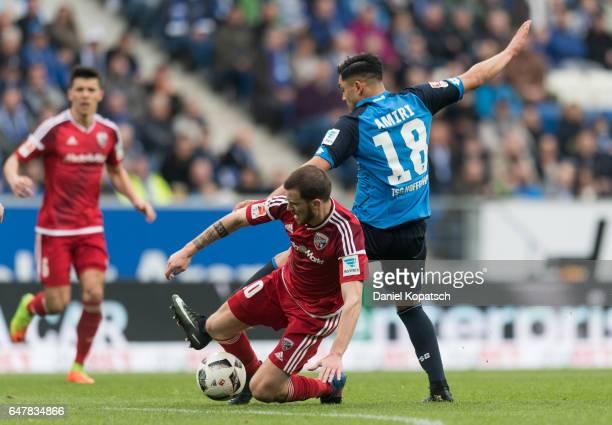 Pascal Gross of Ingolstadt is challenged by Nadiem Amiri of Hoffenheim during the Bundesliga match between TSG 1899 Hoffenheim and FC Ingolstadt 04...