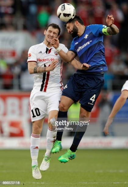 Pascal Gross of Ingolstadt jumps for a header with Aytac Sulu of Darmstadt during the Bundesliga match between FC Ingolstadt 04 and SV Darmstadt 98...