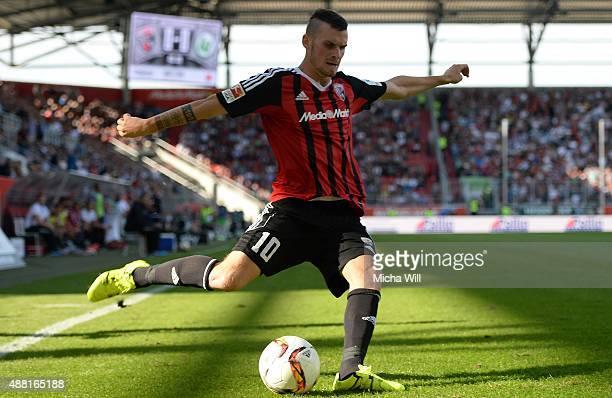 Pascal Gross of Ingolstadt kicks the ball during the Bundesliga match between FC Ingolstadt and VfL Wolfsburg at Audi Sportpark on September 12 2015...