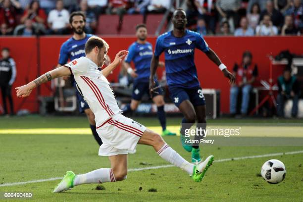 Pascal Gross of Ingolstadt scores his team's first goal during the Bundesliga match between FC Ingolstadt 04 and SV Darmstadt 98 at Audi Sportpark on...