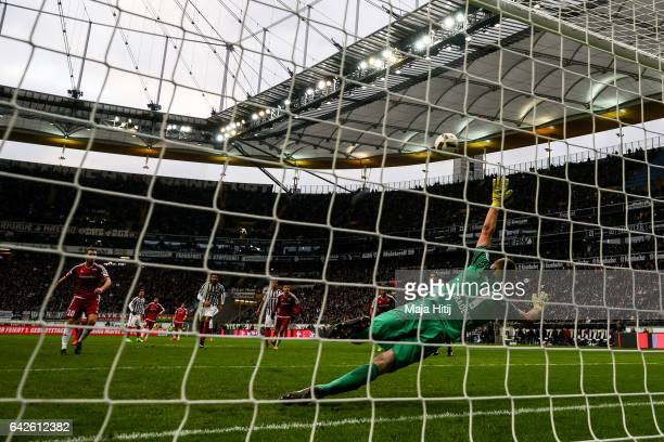 Pascal Gross of Ingolstadt scores penalty shot to make it 02 against Lukas Hradecky goal keeper of Frankfurt during the Bundesliga match between...