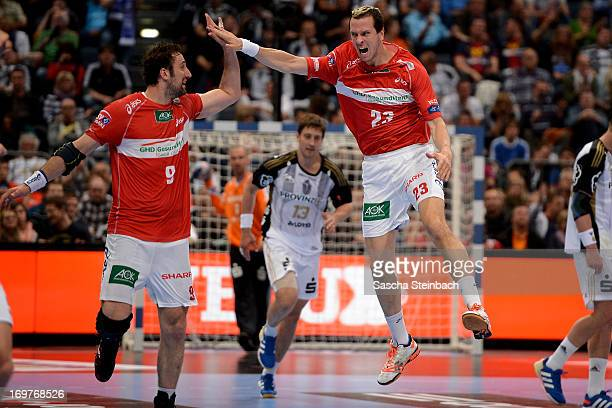 Pascal Hens and Igor Vori of Hamburg celebrate during the EHF Final Four match between THW Kiel and HSV Hamburg at Lanxess Arena on June 1 2013 in...