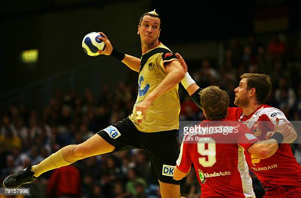 Pascal Hens of Germany in action with Gudjon Valur Sigurdsson and Robert Gunnarsson of Iceland during the Men's Handball European Championship main...