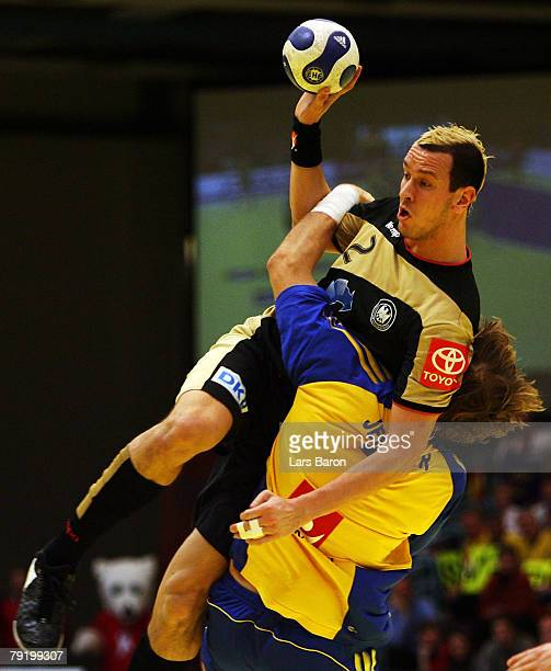 Pascal Hens of Germany in action with Magnus Jernemyr of Sweden during the Men's Handball European Championship main round Group II match between...