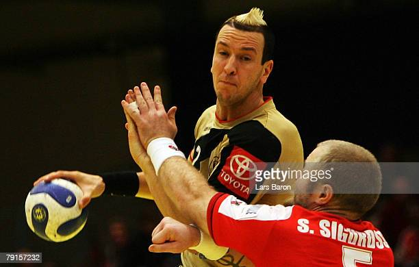 Pascal Hens of Germany in action with Sigfus Sigurdsson of Iceland during the Men's Handball European Championship main round Group II match between...