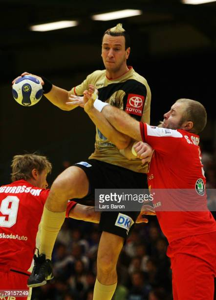 Pascal Hens of Germany is seen in action with Sigfus Sigurdsson of Iceland during the Men's Handball European Championship main round Group II match...