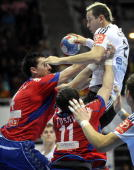 Pascal Hens of Germany vies with Marko Curuvcija and Alem toskic of Serbia during their World Handball Championship match in Zadar on January 24 2009...