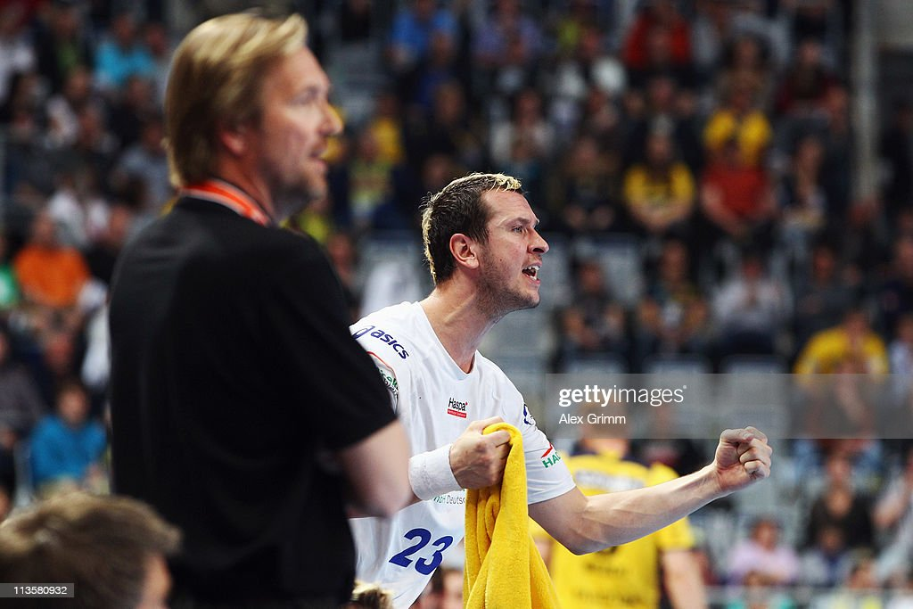 Pascal Hens of Hamburg celebrates after the Toyota Handball Bundesliga match between Rhein Neckar Loewen and HSV Hamburg at SAP Arena on May 3 2011...