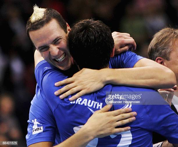 Pascal Hens of Hamburg celebrates victory with team mate Igor Lavrov after the Handball Bundesliga match between HSV Handball and HSG Dusseldorf on...