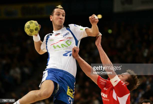Pascal Hens of Hamburg competes with Vladica Stojanovic of Melsungen during the Bundesliga game between HSV Handball and MT Melsungen at the Color...