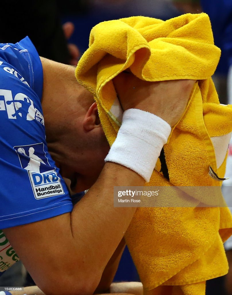 <a gi-track='captionPersonalityLinkClicked' href=/galleries/search?phrase=Pascal+Hens&family=editorial&specificpeople=577208 ng-click='$event.stopPropagation()'>Pascal Hens</a> of Hamburg looks dejected after losing the DKB Handball Bundesliga match between HSV Hamburg and THW Kiel at the O2 World on October 27, 2012 in Hamburg, Germany.