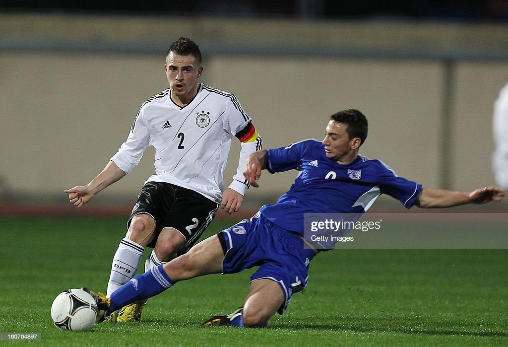 Pascal Itter (l) of Germany is challenged by Makris Andreas of Cyprus during the international friendly match between U18 Cyprus and U18 Germany at Stadio Tasos Markou on February 5, 2013 in Paralimni, Cyprus.