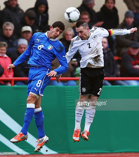 Pascal Itter of Germany jumps for a header with Luca Crecco of Italy during the U18 international friendly match between Germany and Italy at...
