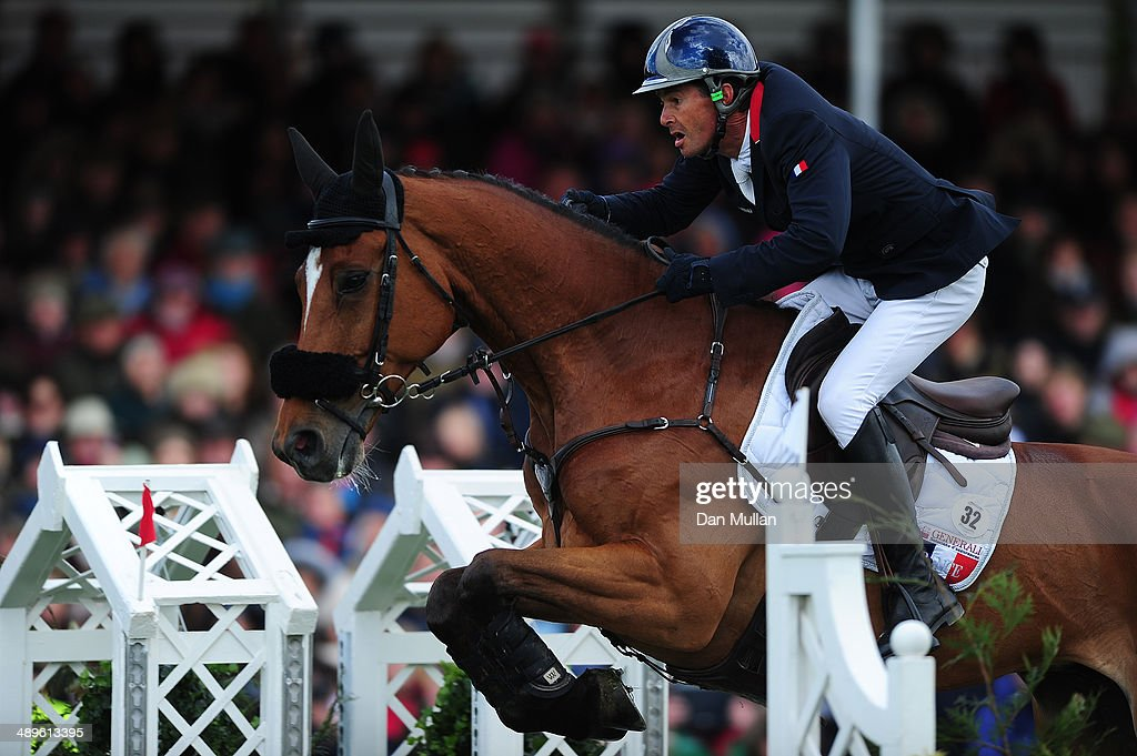 Pascal Leroy of France riding Minos de Petra during the Show Jumping on day five of the Badminton Horse Trials on May 11, 2014 in Badminton, England.