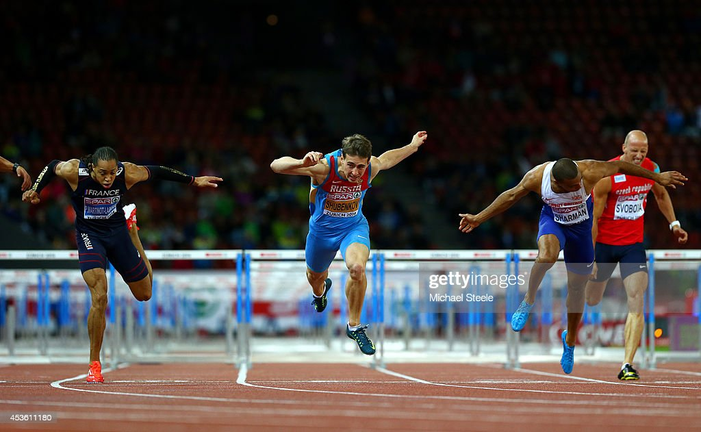 <a gi-track='captionPersonalityLinkClicked' href=/galleries/search?phrase=Pascal+Martinot-Lagarde&family=editorial&specificpeople=7114926 ng-click='$event.stopPropagation()'>Pascal Martinot-Lagarde</a> of France, <a gi-track='captionPersonalityLinkClicked' href=/galleries/search?phrase=Sergey+Shubenkov&family=editorial&specificpeople=8099833 ng-click='$event.stopPropagation()'>Sergey Shubenkov</a> of Russia and William Sharman of Great Britain and Northern Ireland cross the finish line in the Men's 110 metres hurdles final during day three of the 22nd European Athletics Championships at Stadium Letzigrund on August 14, 2014 in Zurich, Switzerland.
