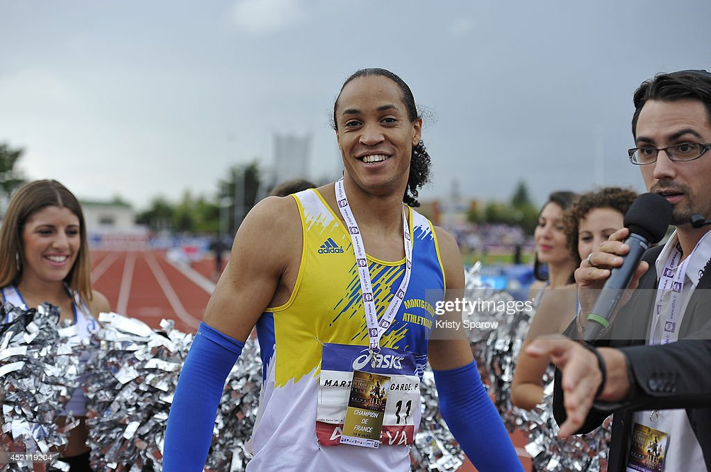 <a gi-track='captionPersonalityLinkClicked' href=/galleries/search?phrase=Pascal+Martinot-Lagarde&family=editorial&specificpeople=7114926 ng-click='$event.stopPropagation()'>Pascal Martinot-Lagarde</a> wins first place in the 110 Meter Hurdles during the Championnats de France d'Athletisme Elite on July 13, 2014 in Reims, France.
