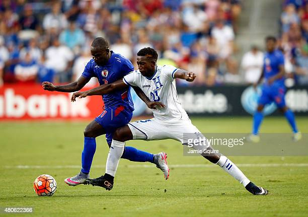 Pascal Millien of Haiti and Johnny Palacios of Honduras compete for the ball during the 2015 CONCACAF Gold Cup match at Sporting Park on July 13 2015...