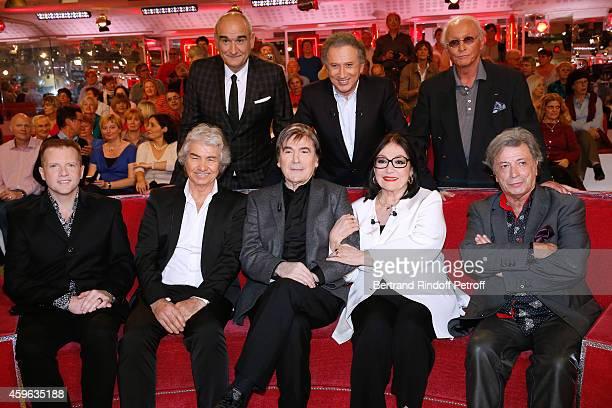 Pascal Negre Michel Drucker Jacques Revaux Martin Fontaine Daniel Guichard Serge Lama Nana Mouskouri and Herve Vilard attend the 'Vivement Dimanche'...