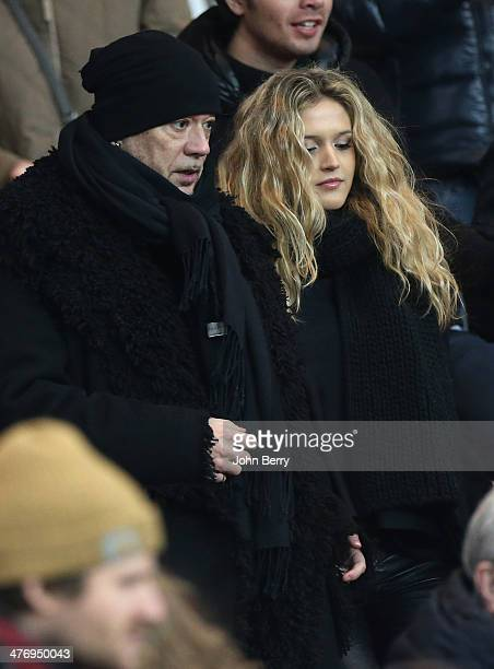 Pascal Obispo and his girlfriend attend the Ligue 1 match between Paris SaintGermain FC and Olympique de Marseille at Parc des Princes stadium on...