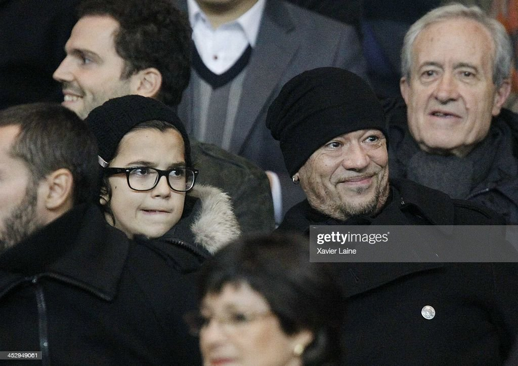 <a gi-track='captionPersonalityLinkClicked' href=/galleries/search?phrase=Pascal+Obispo&family=editorial&specificpeople=549855 ng-click='$event.stopPropagation()'>Pascal Obispo</a> (R) and his son attend the French Ligue 1 between Paris Saint-Germain FC and Olympique Lyonnais at Parc Des Princes on December 1, 2013 in Paris, France.